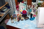 All my perfumes. The little white basket in the back has perfumed lotions.