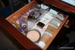 Top left drawer: Face/base products and some small tools and eyelashes