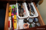 Top right drawer: Eyeliners and mascara. On the far right basket is blue, green & purple liners and the left has black, brown and metallics.