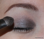 Apply a silvery gray from the inner corner to about mid-lid.