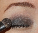 Then, apply a darker gunmetal gray from mid-lid outward. Both colors should be blended into the crease.