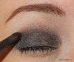 Then, take a shimmery soft black and blend into and slightly above your natural crease.