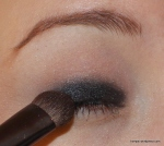 First, use a matte black shadow on the entire lid, just under the crease.