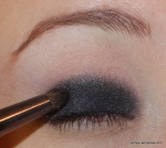 Third, use a shimmery blackened steel in the natural crease.